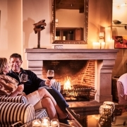 2 People at the fireplace drinking a glass of wine, Western Cape Accommodation