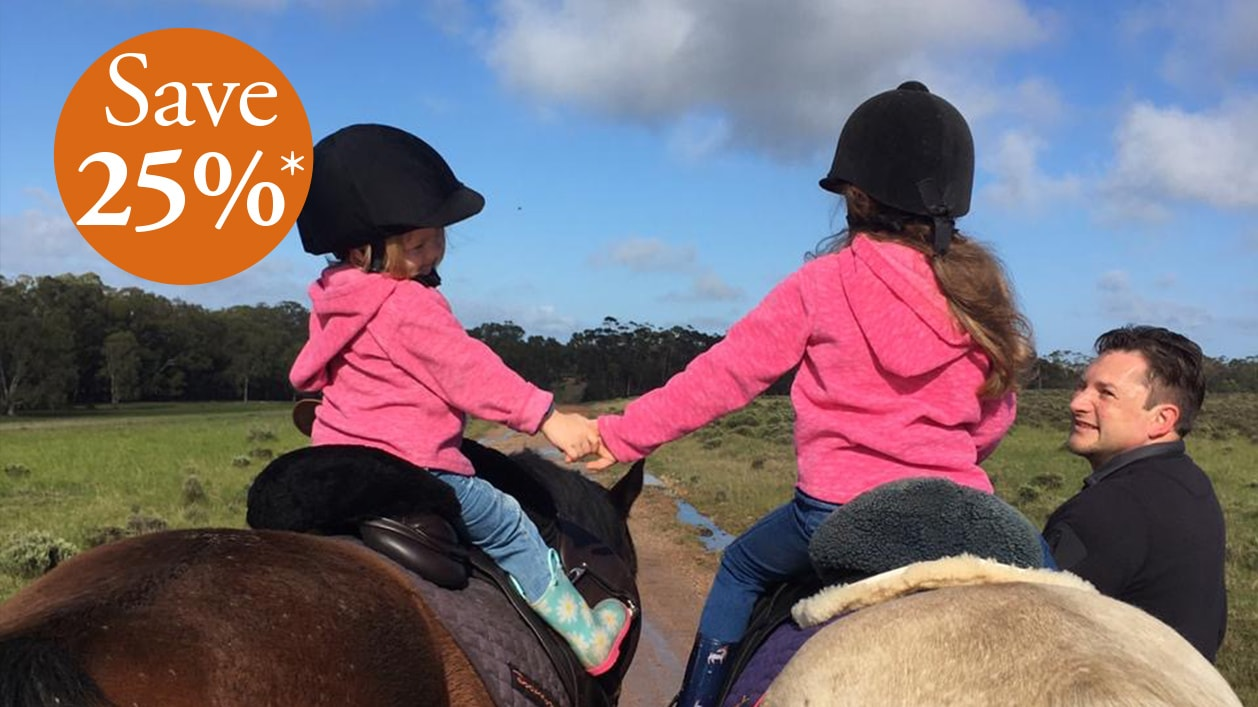 Two children on horses at Doornbosch Game Lodge & Guest Houses, Western Cape