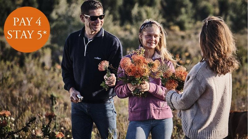 3 People in the fynbos smiling