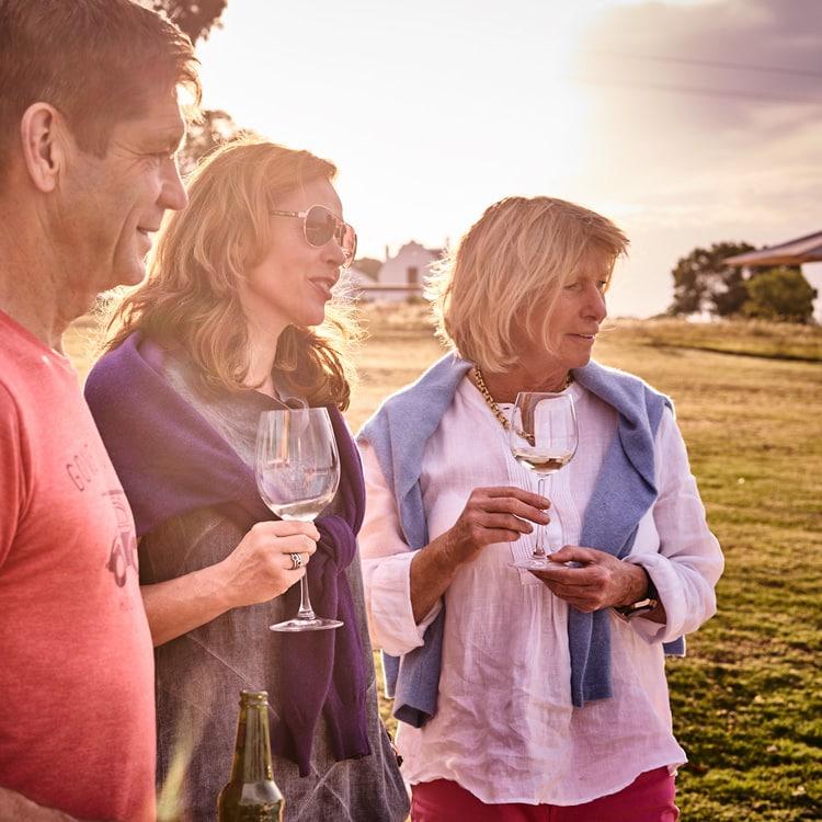 3 people at Doornbosch with glass of wine