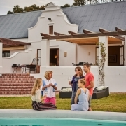 Relaxed people at the pool at Doornbosch Gamelodge & Guesthouses, Western Cape